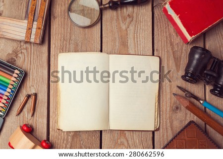 Notebook mock up for artwork or logo design presentation with hipster objects. View from above - stock photo