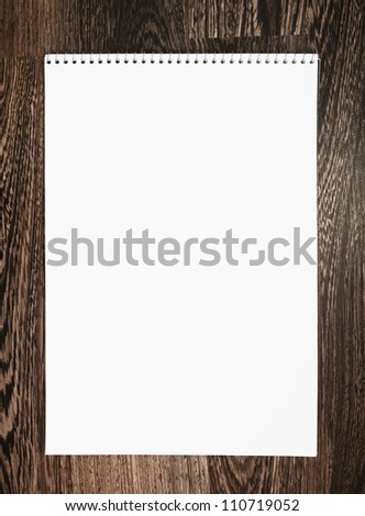 Notebook on a wooden background. - stock photo