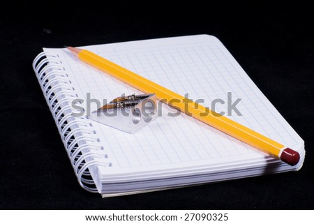 notebook on black background