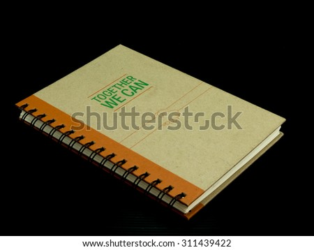 notebook on black background with copy space