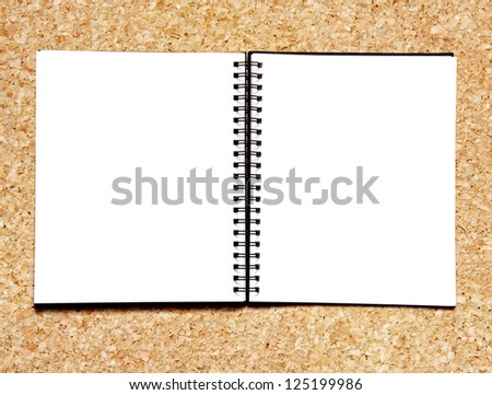 Notebook on cork background - stock photo
