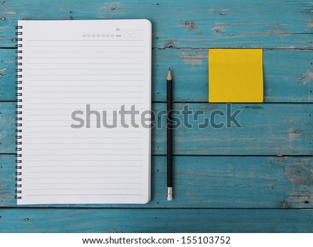Notebook on desk - stock photo