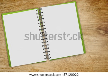 notebook on table - stock photo