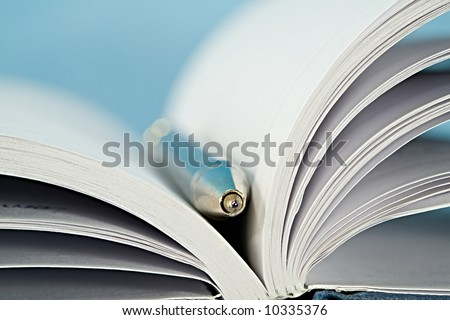 notebook open with a pen