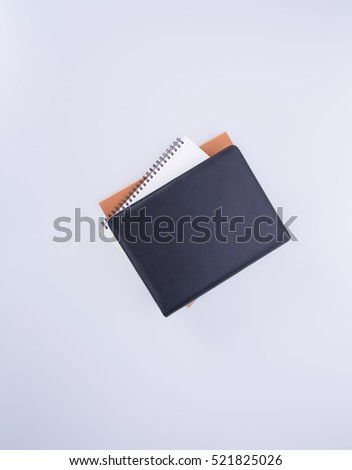 notebook or black leather notebook on the blackground