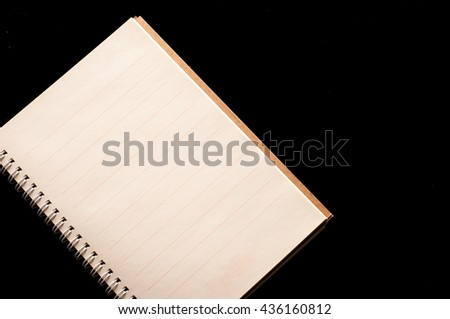Notebook organizer use in business office black background - stock photo