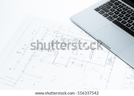 Notebook over house construction blueprint with blue tone effect, useful for construction, business, architecture, engineering, insurance background concepts