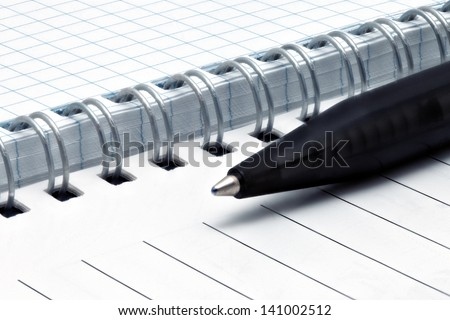 Notebook pages with pen. Isolated over white - stock photo