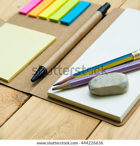notebook paper and pen top view on wood pallet background
