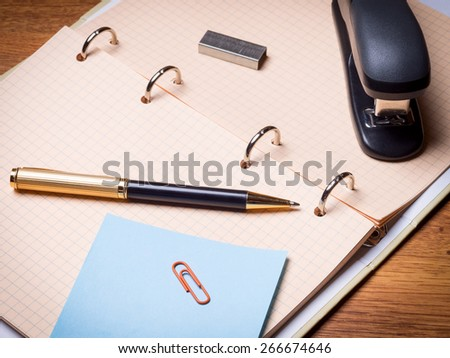 Notebook, pen, stapler and some other stationery - stock photo
