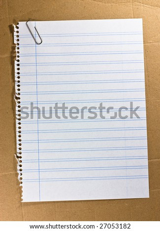 notebook sheet on cardboard texture - stock photo