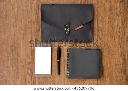Notebook, smart-phone and stationery with copy space background  - stock photo