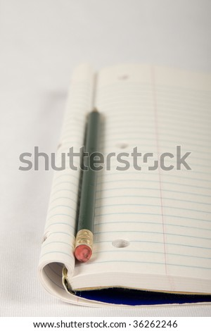 Notebook spine with pencil - stock photo