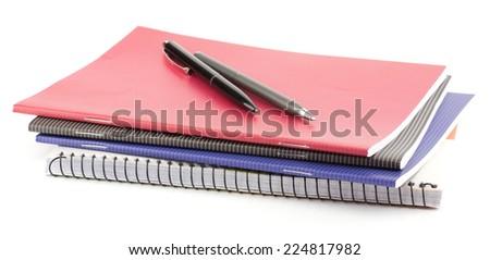 Notebook stack, pen, pencils. Schoolchild and student studies accessories. Back to school concept. - stock photo