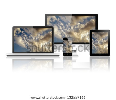 Notebook, tablet pc, mobile phone and computer - stock photo