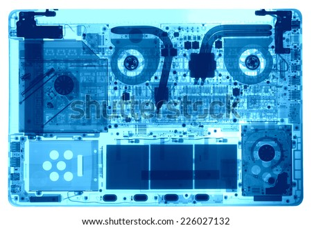 Notebook under the X-rays in blue tones - stock photo