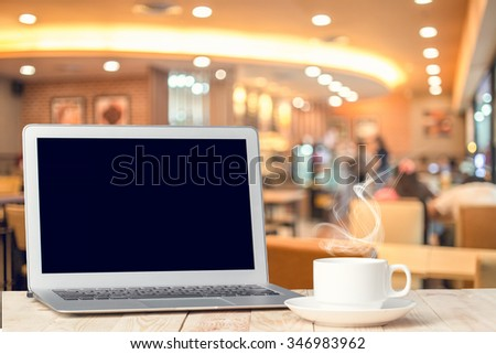 Notebook with a coffee cup. - stock photo