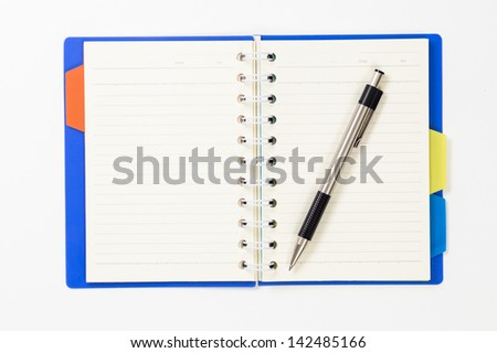 Notebook with a pen isolated on white background