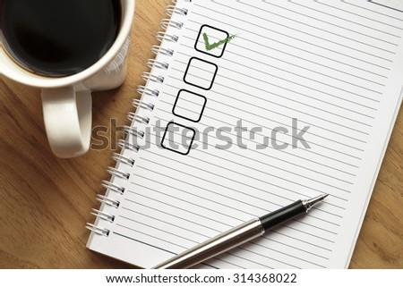 Notebook with blank checklist - stock photo