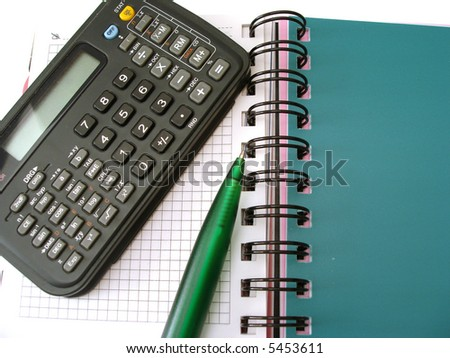 notebook with calculator and pen - stock photo
