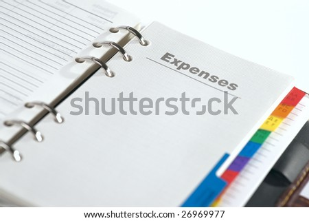 "Notebook with copy ""expenses"", shallow focus - stock photo"
