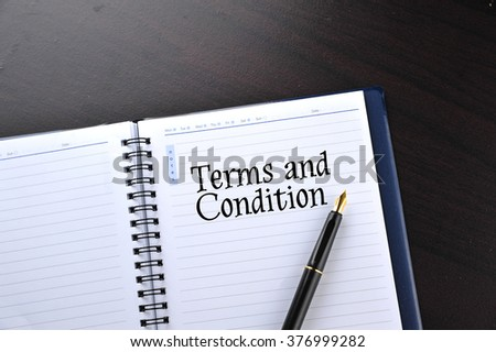 Notebook with fountain pen written word Terms and Condition - stock photo
