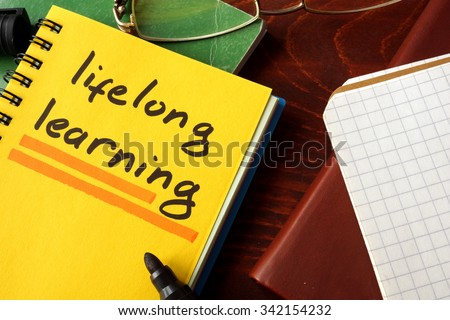 Notebook with lifelong learning  sign. Education concept. - stock photo