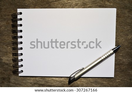 Notebook with pen and pencil on wooden table, business concept - stock photo