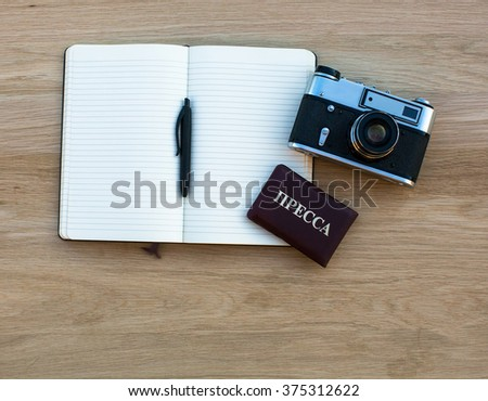 Notebook with pen, camera and Russian Press ID. - stock photo