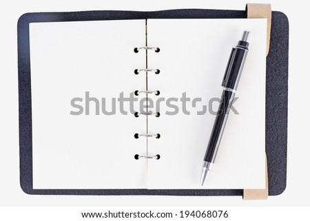 notebook with pen isolated on white - stock photo