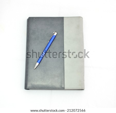 Notebook with Pen on the White background - stock photo
