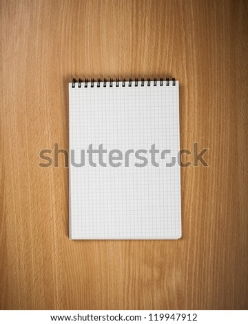 Notebook with pen on wood background - Back to school concept - stock photo