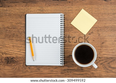 Notebook with pencil Adhesive Note and cup of coffee, Planning