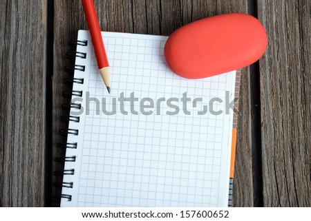 notebook with pencil and eraser - stock photo