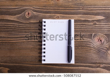 notebook with plans for a wooden background