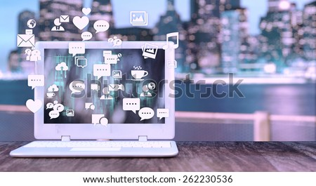 Notebook with social media related icons and blurred night city in the background. Social media concept with space for text on the right side. - stock photo