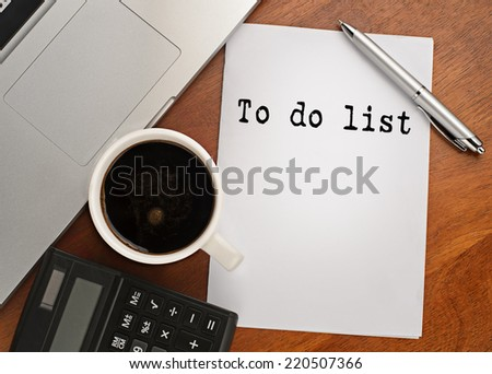 Notebook with text to do list on table with coffee, calculator and notebook  - stock photo