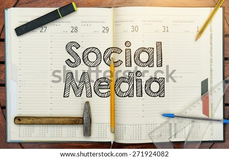 notebook with the note in the center social media - stock photo