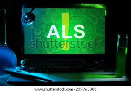 Notebook with words  als , test tubes and stethoscope - stock photo