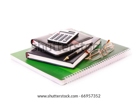 Notebooks, calculator and glasses isolated on white - stock photo