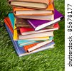 Notebooks in the grass. Close up. Nobody. - stock photo