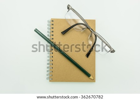 Notebooks , pencils, glasses - stock photo