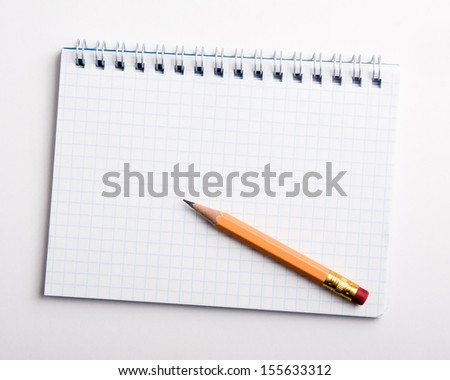 Notepad and a pencil - stock photo