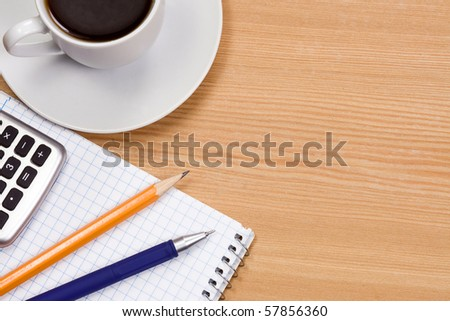 notepad and coffee at table - stock photo