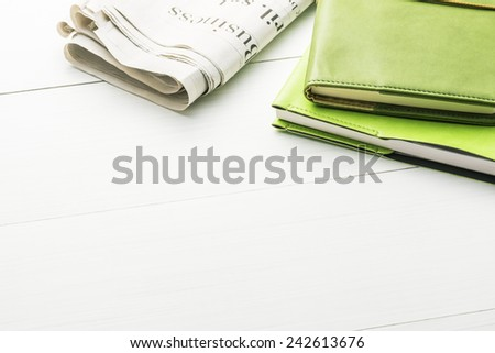 Notepad and Newspaper.Office supply on Blank Desk. - stock photo