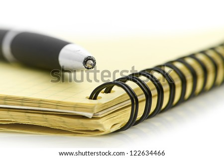 notepad and pen isolated on white background - stock photo