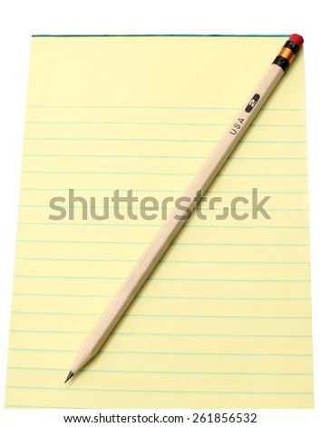 notepad and pencil on white background