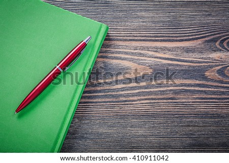 Notepad brio pen on wooden board copy space. - stock photo