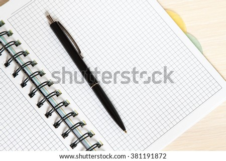 Notepad, diary and a pen on the desk
