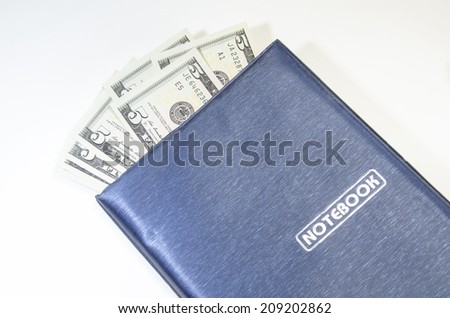 notepad on dollars background
